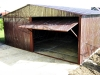 Garaż blaszany dwuspadowy ciemny brąz RAL 8017 bramy uchylne